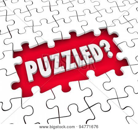 Puzzled word in 3d letters in a hole for missing pieces to illustrate a feeling of being lost, confused, stumped or baffled