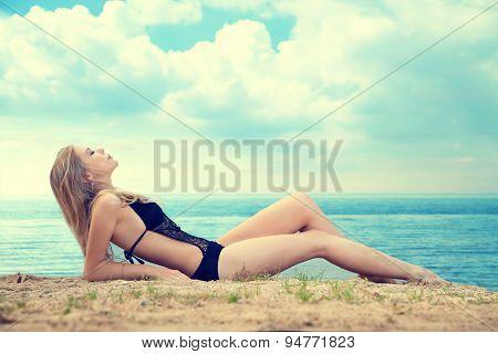 Girl Lying On The Beach, Sunbathing And Relaxing.