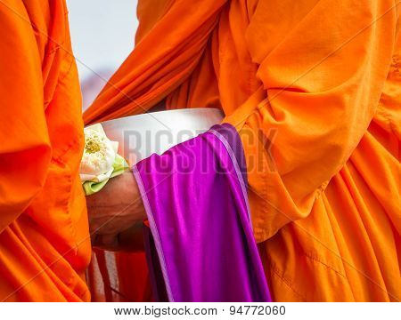 Buddhist Monk Holding Alms Bowl And Lotus Flower
