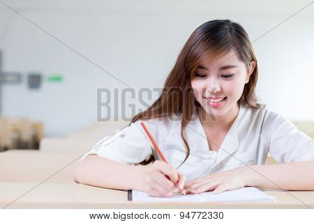 Asian beautiful female student study portrait in classroom