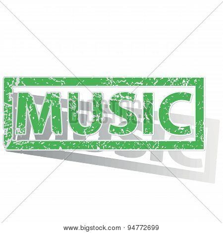 Green outlined MUSIC stamp
