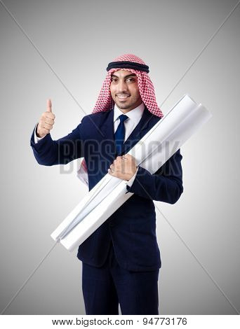 Arab engineer with drawings against gradient
