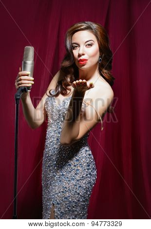 beautiful girl with a microphone retro
