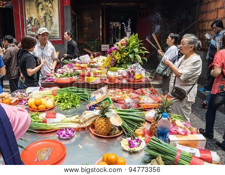 people pray and offering in Longshan temple in Taipei, Taiwan