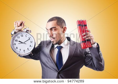 Businessman with dynamite against the gradient