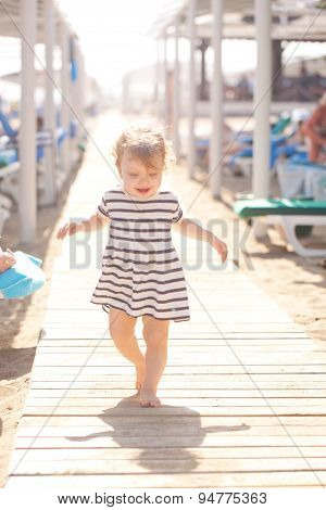 Baby Walking Along Wooden Walkway