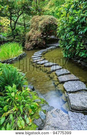 The track of  stones in Japanese part of garden. Beautiful decorative private garden in western Canada
