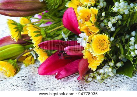 Summer flower arrangement on a white tablecloth