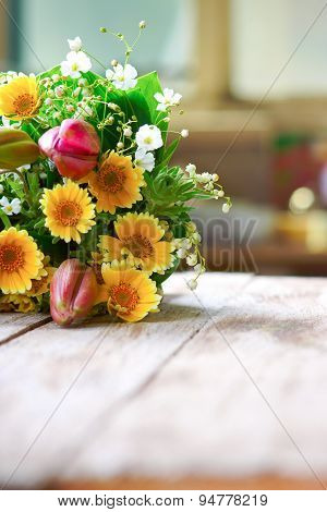 Summer flowers on the wooden table