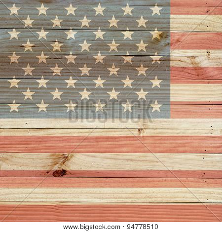 American flag on light brown wood background.