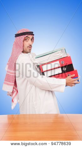 Arab businessman with many folders against gradient