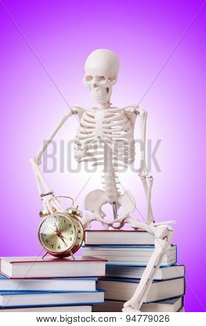 Skeleton reading books against gradient