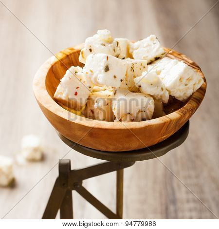 Cubed feta cheese on old scales