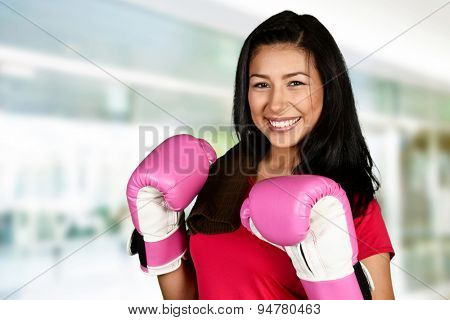 Young woman doing a kick boxing workout