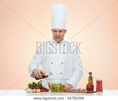 profession, vegetarian, food and people concept - happy male chef cooking salad over beige background