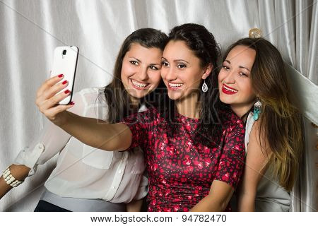 Group Of Cheerful Smiling Women Make Selfie