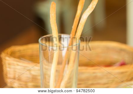 Glass With Salted Bread Sticks