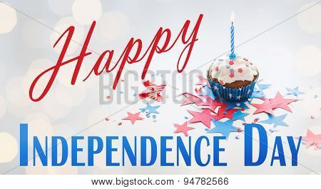 happy independence day, celebration, patriotism and holidays concept - close up of cupcake or muffin with burning candle and stars cofetti decoration on table at 4th july party