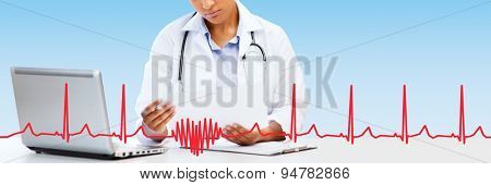 healthcare, medical diagnosis and technology concept - african female doctor with laptop pc computer looking at medical report over blue background with red heart shape and cardiogram
