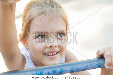 Five-year Girl Climbs The Ladder On Playground