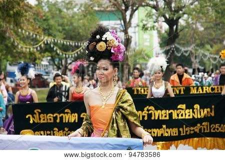 Thai People On The Parade In Chiangmai Flower Festival 2013