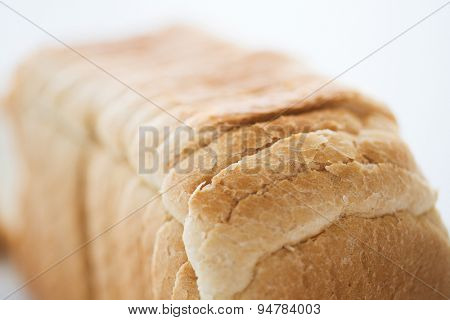 food, junk-food and unhealthy eating concept - close up of white toast bread