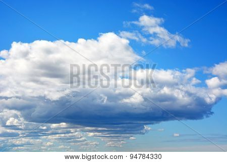 Fluffy Clouds On The Blue Sky. Natural Background