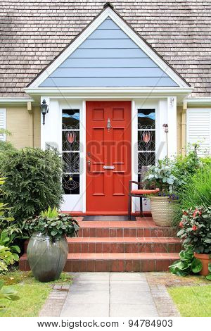 Charming little house with a colorful front door.