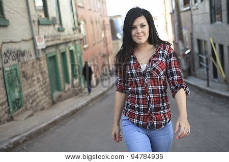 Cheerful woman in the street walking