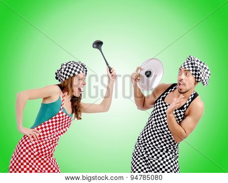 Pair of funny cooks against gradient