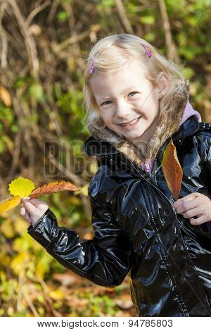 portrait of little girl in autumnal nature