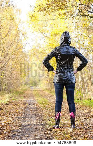woman wearing rubber boots in autumnal nature