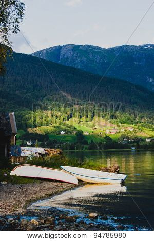 Two boats on the shore in Ulvik, Norway