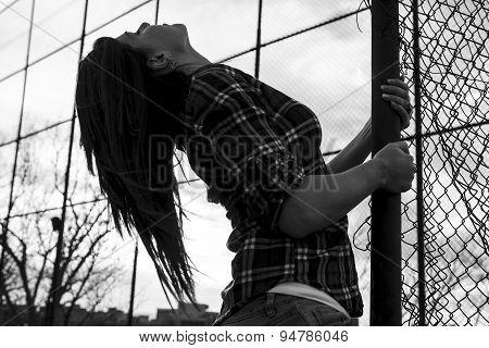 woman holding a fense