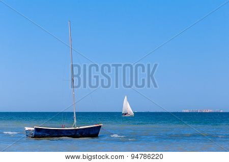 Calm blue sea with sailboats