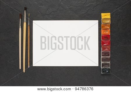 Sheet Of Paper And Water Colors On The Table