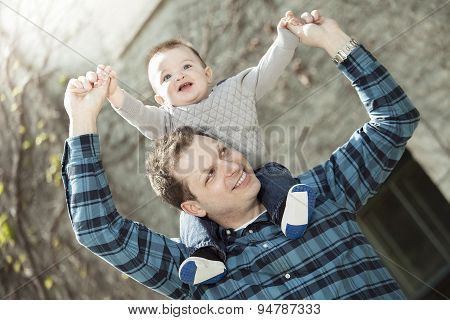 Young dad with her baby boy