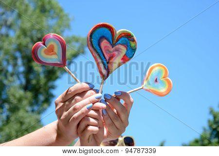 Three Lollipops In Woman's An Kid's Hands