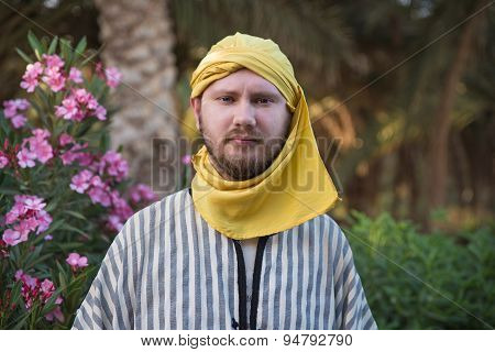 Man wearing traditional bedouin clothing in Sahara desert. Douz, Tunisia