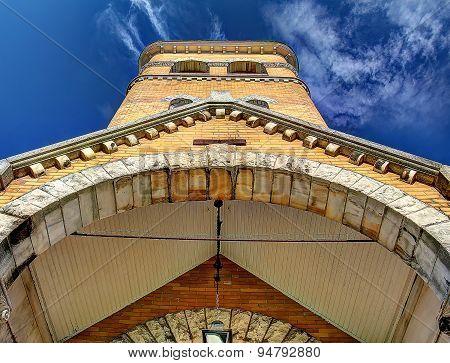 Looking Up At A Brick Church Steeple