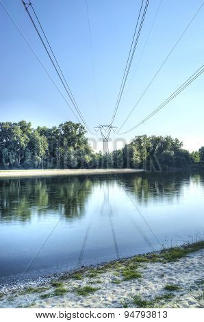 Power line over a river. Color image