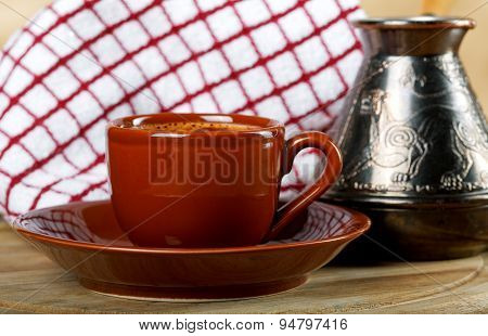 Cup Of Coffee With A Coffee Maker And A Towel