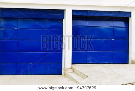 Artsy strong blue colored garage doors