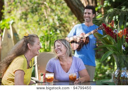 Mature Friends With Ukelele Player
