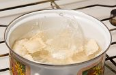 stock photo of boiling water  - the dumplings cooks in a pan with the boiling water - JPG