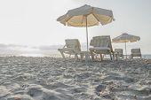 stock photo of greek-island  - Sunset sandy beach on Greek Kos island with parasols and sunbeds - JPG