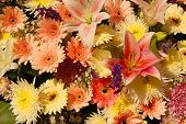 stock photo of funeral  - mixed flowers in a wreath at a thai funeral - JPG