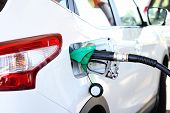 stock photo of fuel economy  - refilling the car with fuel in gas station - JPG