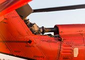 image of military helicopter  - Orange military helicopter at the airport closeup - JPG
