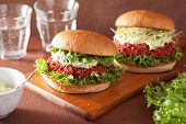 stock photo of quinoa  - vegan beet and quinoa burger with avocado dressing - JPG